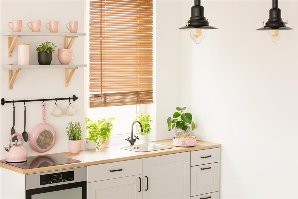 kitchen with pink and white theme