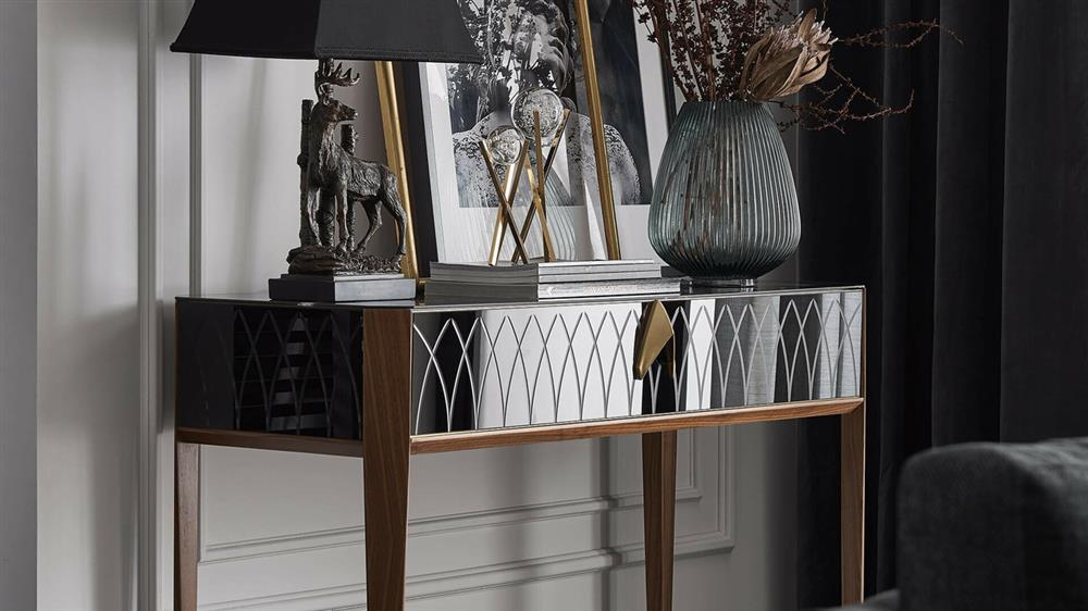 mirrored dresser in the living room